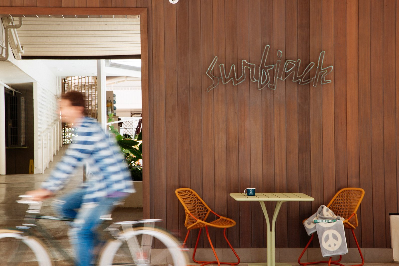 When you first approach the Surfjack, a handmade copper sign welcomes you that was created by Jason Dow, a local jewelry designer. Tagged: Dining Room, Chair, and Table.  Photo 2 of 14 in This Surf-Inspired Hotel Celebrates Waikiki's Creative Spirit and its Midcentury Roots