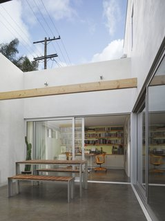A Perforated Screen Brings Privacy and Natural Light to This Bold Venice Home - Photo 9 of 9 -