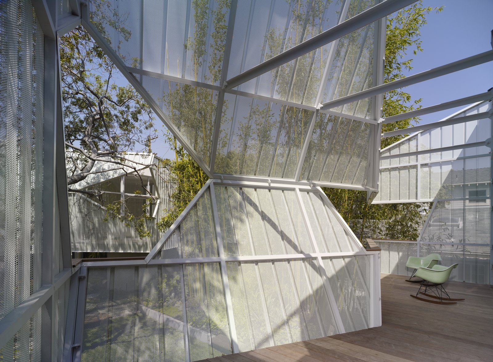 Photo 9 of 10 in A Perforated Screen Brings Privacy and Natural Light to This Bold Venice Home