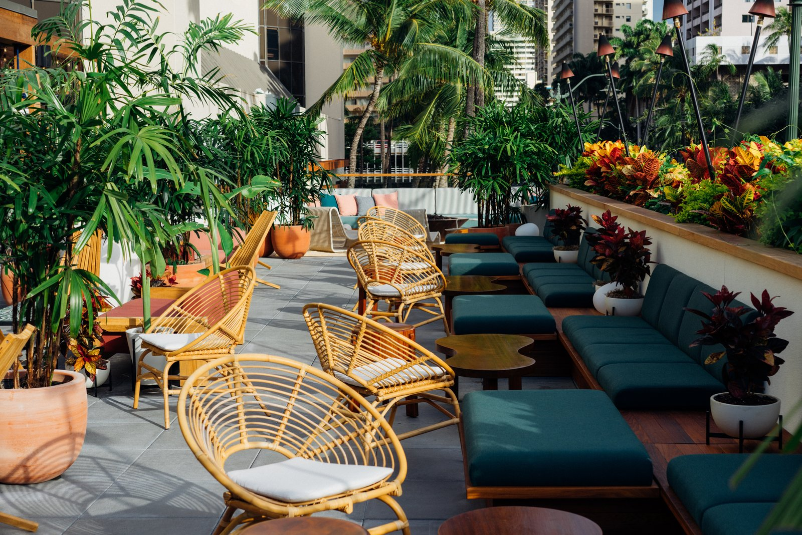 Throughout the hotel, the designers sourced a mix of new, custom, and vintage furnishings. The outdoor spaces include furniture by Kettal, custom cabanas, and lounges inspired by Locus Solus Lounge Chairs.  Photo 6 of 18 in Waikiki's Midcentury Revival Continues to Flourish With a New Jet Set-Inspired Hotel