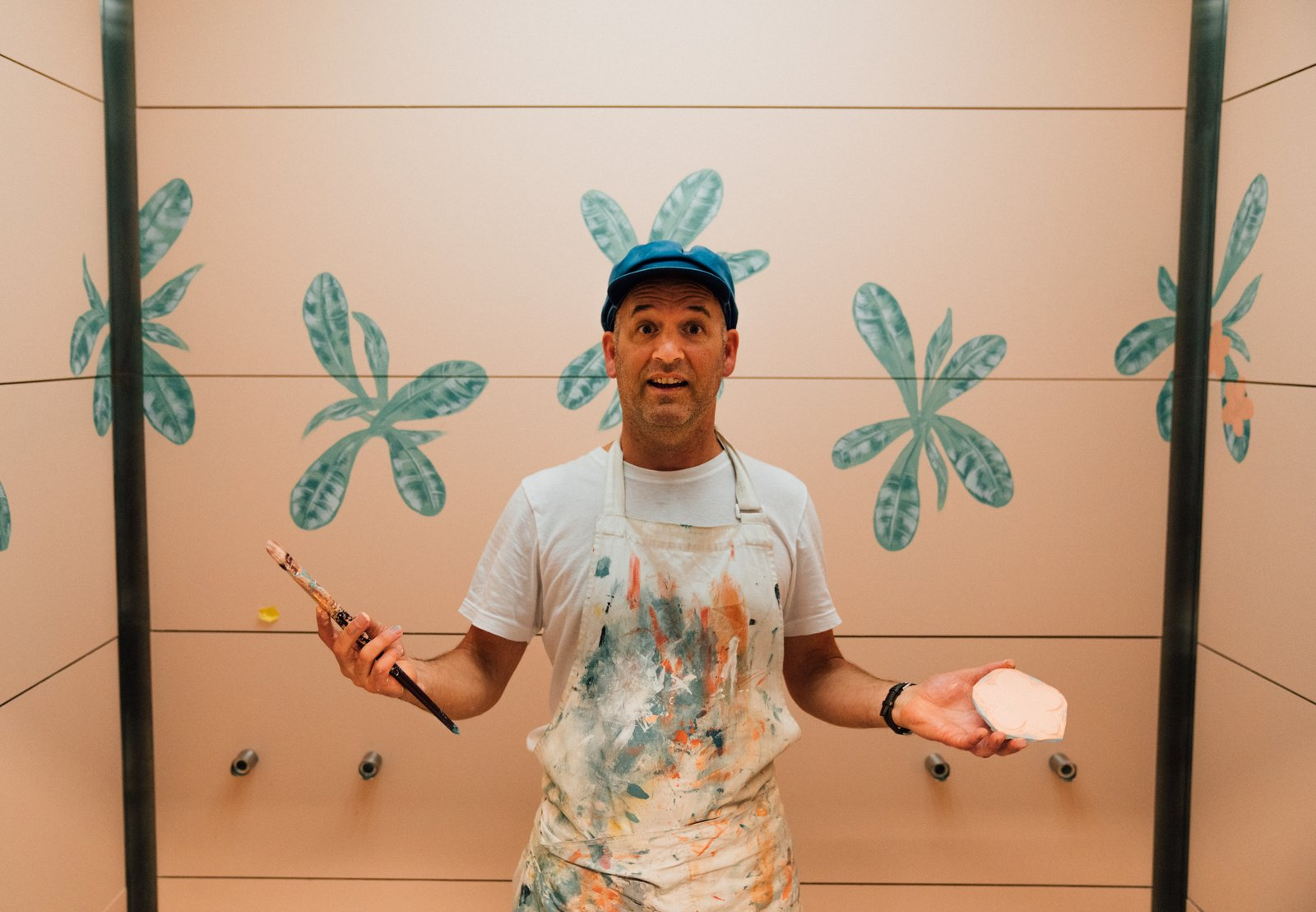 Michael Paulus spent a week painting hand-painted floral murals in the elevator cabs and restroom vestibule.  Photo 12 of 18 in Waikiki's Midcentury Revival Continues to Flourish With a New Jet Set-Inspired Hotel