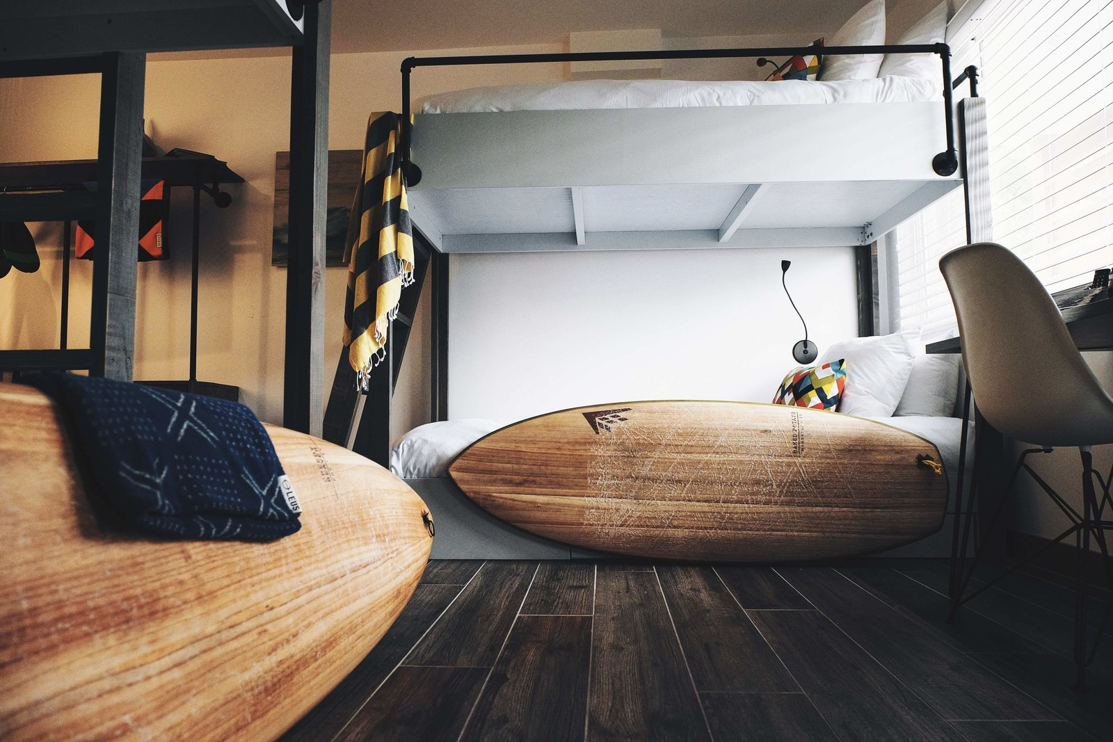 """A New Modern Hotel in San Diego Offers Surfing Adventures and Local Hospitality - Photo 8 of 10 - Each of the rooms can accommodate two guests, except for """"Pipes,"""" which includes a set of camp-style bunk beds that can fit four people. Guests have access to the hotel's surf equipment, including a quiver that's filled with Firewire surfboards. They also have partnerships set up with a handful of other local business so that they can offer guests whatever it takes to complete the experience."""