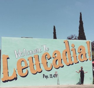 "A New Modern Hotel in San Diego Offers Surfing Adventures and Local Hospitality - Photo 1 of 10 - A ""Welcome to Leucadia!"" sign leads visitors with open arms onto the quaint block where Surfhouse sits. It borders a community coffee joint called Coffee Coffee, as well as Surfy Surfy, an old-school surf shop that began as a surf blog in 2005 where JP St Pierre documented his family surfboard factory called Moonlight Glassing. In 2010, Pierre teamed up with a few of his surf buddies to open up Surfy Surfy, which is the same group that later opened up Coffee Coffee. Both destinations were part of a community effort to make sure local businesses continue to rule there."