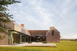 8 Barn Houses For Modern Living - Photo 2 of 8 - This beautiful property located in West Flanders, Belgium has an impressively rich history. Built in 1839, the buildings were used as a fort, watch point and jail house, while some brick and concrete bunkers on the property date back to WWI.