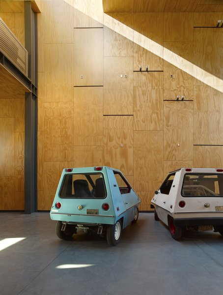 The owner had been fixing up cars and trucks since high school, and wanted a place where he could work on his collection of old step-vans and 70s electric cars.   #garage #interiorarchitecture #interior #sanfrancisco #workshop #interstice #intersticearchitects #cesarrubio #cesarrubiophotography Photo 16 of Minna Street DREAM:shop modern home