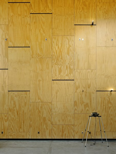 The walls are lined with a grid of plywood panels that can be rearranged as needed.  #interior #interiorarchitecture #sanfrancisco #workshop #interstice #intersticearchitects #cesarrubio #cesarrubiophotography Photo 14 of Minna Street DREAM:shop modern home