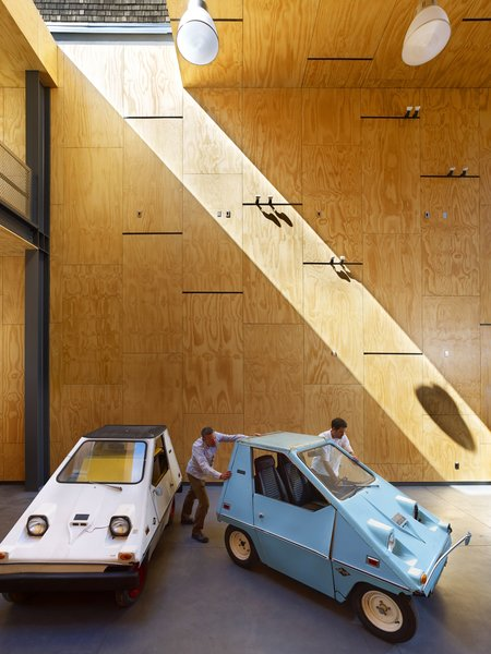 The client collects '70s Vanguard-Sebring electric CitiCars, and wanted a place where he could work on them and tinker.   #garage #interiorarchitecture #interior #sanfrancisco #workshop #interstice #intersticearchitects #cesarrubio #cesarrubiophotography Photo 3 of Minna Street DREAM:shop modern home