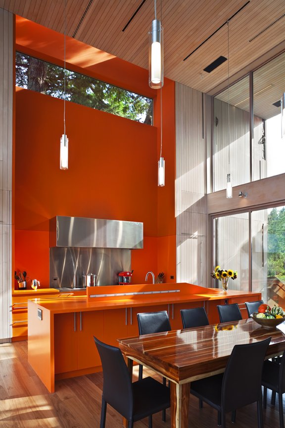 High ceilings in the kitchen and dining room  #kitchen #diningroom #orange #bright #color #beachhouse #beachhouses #vancouverisland #britishcolumbia #view #interstice #intersticearchitects #bradlaughtonphotography #bradlaughton Comme