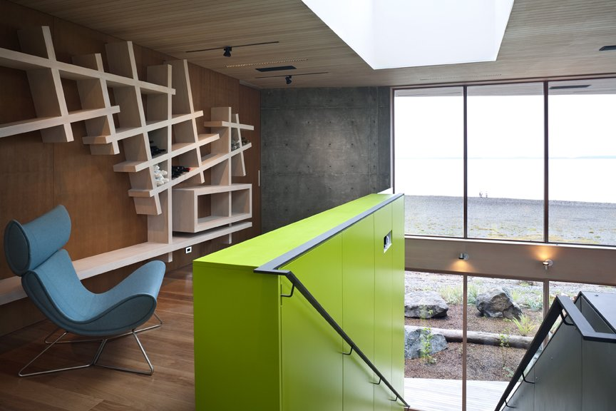 An intimate, peaceful study area at the top of the staircase provides a quiet moment for guests, and unique storage solutions in the cabinetry and shelving.   #shelving #green #limegreen #bright #color #staircase #storage #beachhouse #beachouses #interstice #intersticearchitects #bradlaughton #bradlaughtonphotography #britishcolumbia #vancouverisland   TreeHugger by INTERSTICE Architects