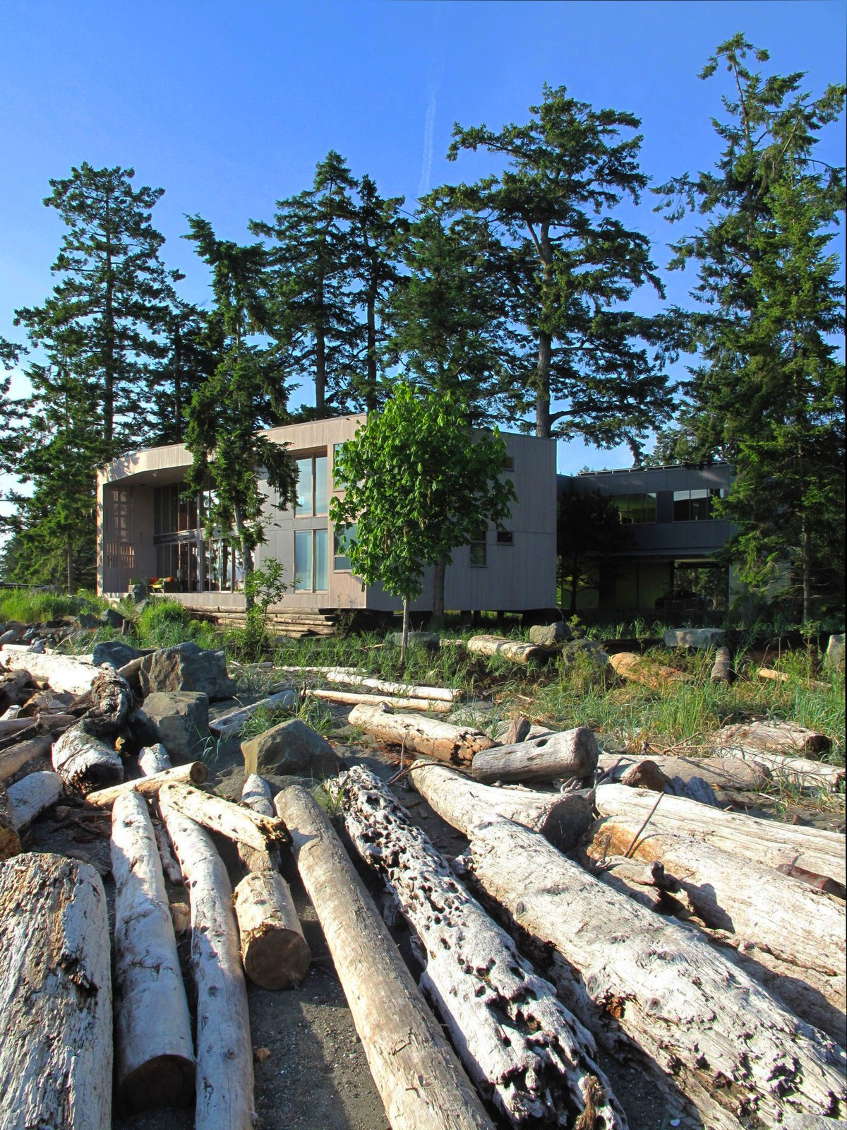 The house is designed to weather to a silver grey – becoming a modern drift wood box piled on the beach with the ever-changing storm debris.  #beachhouse #facade #beachhouses #outside #outdoors #landscape #interstice #intersticearchitects #britishcolumbia #saratoga #vancouverisland