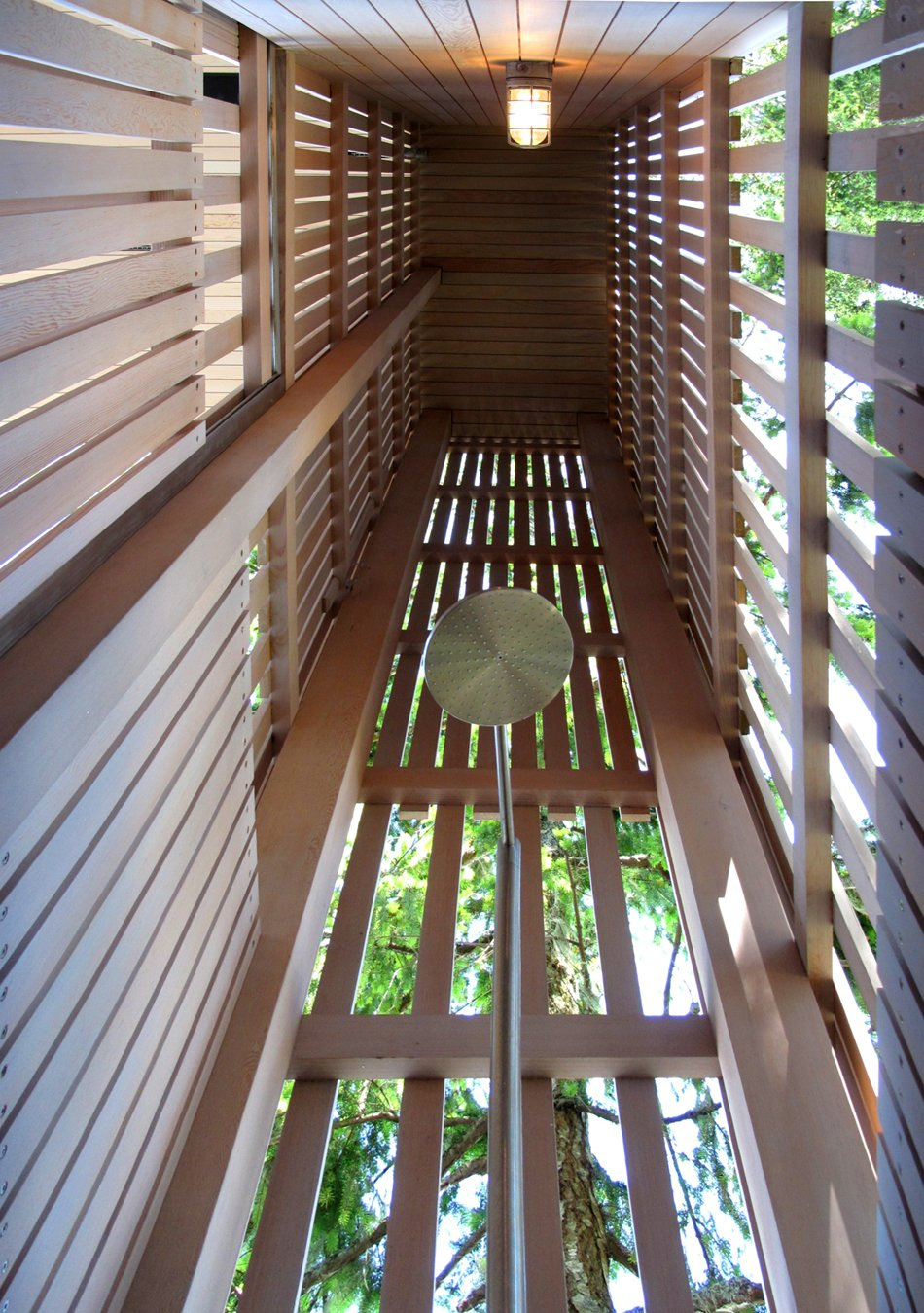 The Main house is clad in the local Douglas fir with deep protective eaves, stained grey to match the sun-bleached drift wood logs that litter the coast. Programmatic elements include like outdoor shower. #shower #outdoorshower #beachhouse #beachhouses #residentialarchitecture #residential #interstice #bradlaughton #britishcolumbia #vancouverisland #highceiling