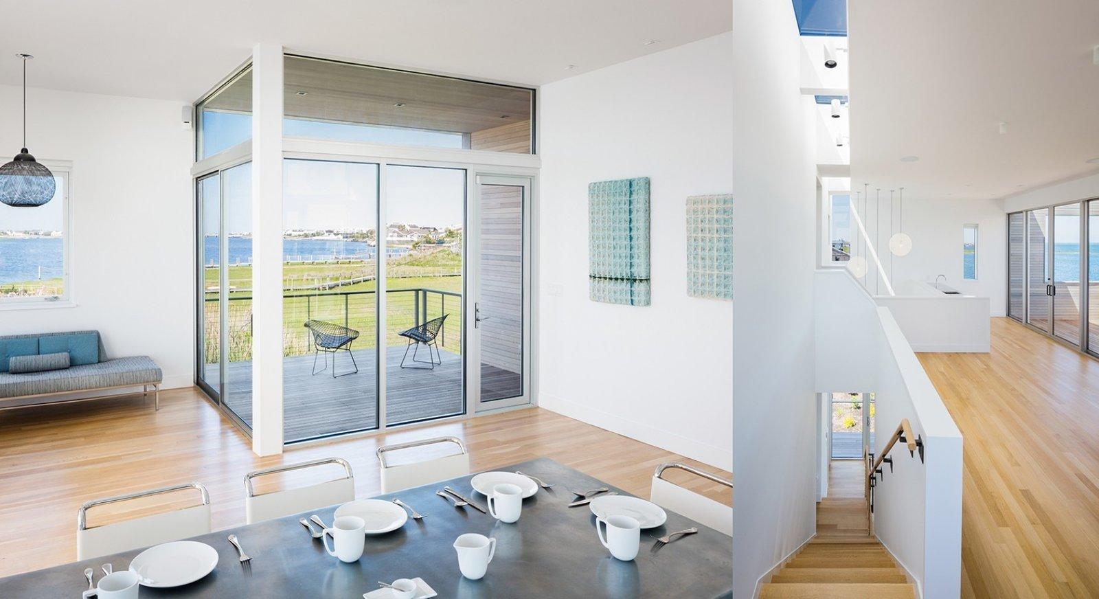 #CubeHouse #interior #inside #staircase #deck #chairs #seating #table #windows #naturallighting #dining #lighting #Westhamptonbeach #NewYork #LeroyStreetStudio   Cube House by Leroy Street Studio
