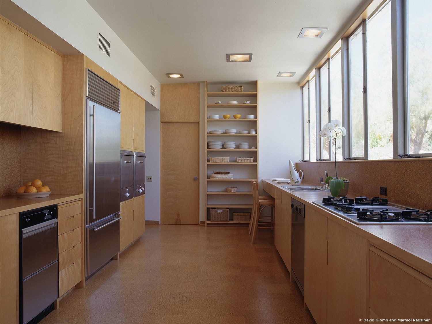 #KaufmannHouse #modern #midcentury #Nuetra #1946 #restoration #archival #original #details #lighting #interior #inside #wood #kitchen #appliances #stove #shelves #PalmSprings #California #MarmolRadziner