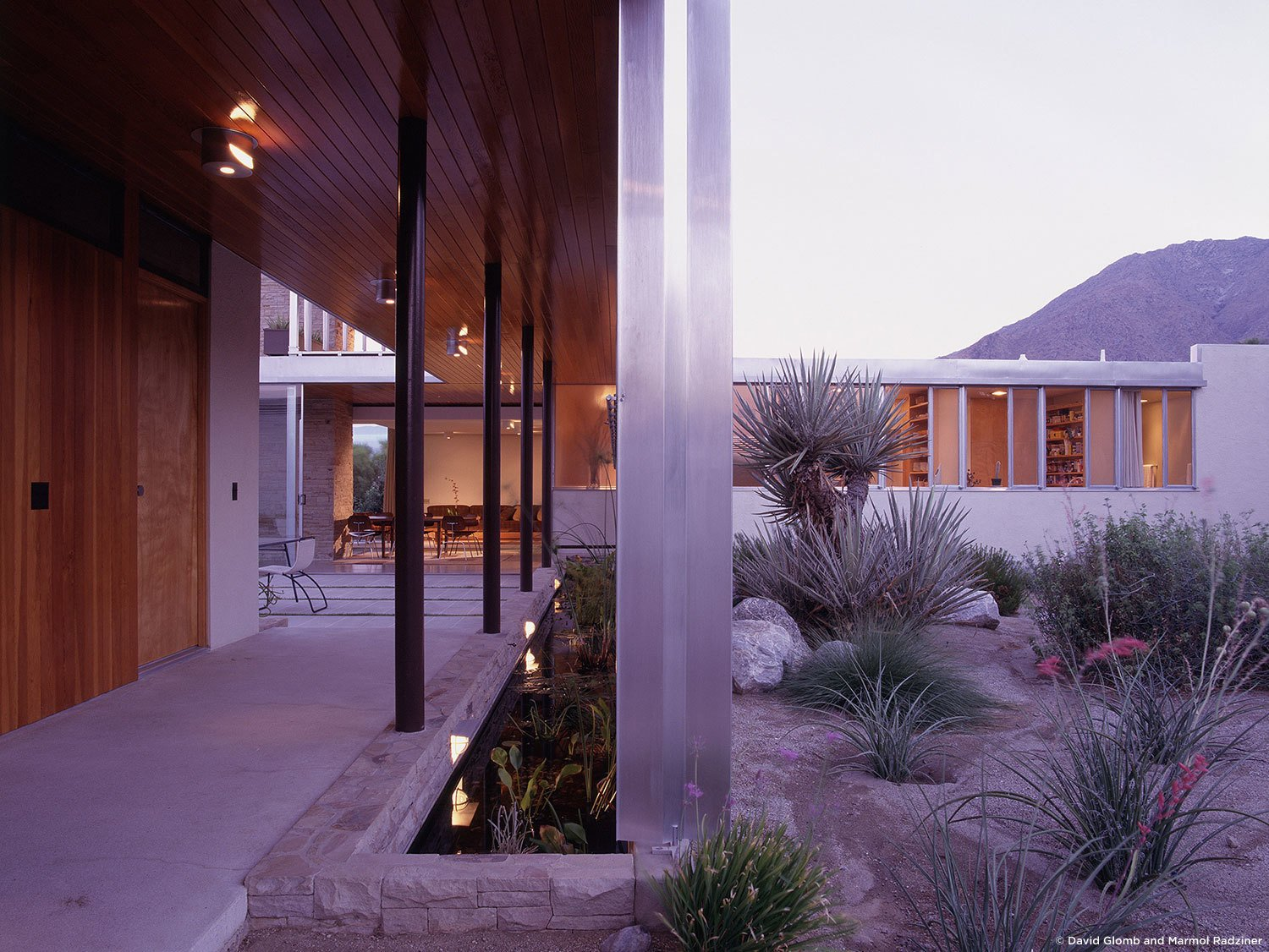 #KaufmannHouse #modern #midcentury #Nuetra #1946 #restoration #archival #original #details #lighting #exterior #outside #outdoors #wood #landscape #plants #PalmSprings #California #MarmolRadziner   Kaufmann House by Marmol Radziner