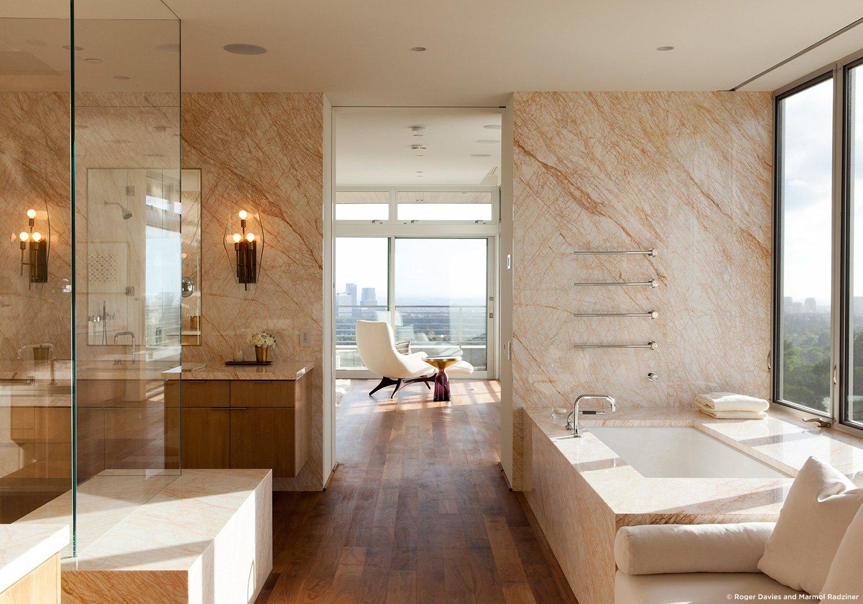 #SummitridgeResidence #modern #midcentury #levels #interior #inside #bathroom #sink #bathtub #windows #view #marble #wood #lighting #BeverlyHills #MarmolRadziner  Summitridge Residence by Marmol Radziner