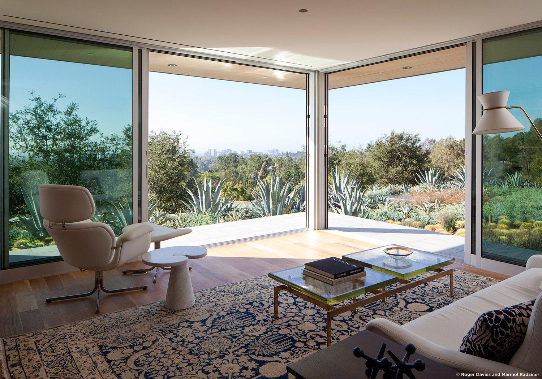 #SummitridgeResidence #modern #midcentury #levels #interior #inside #seating #outdoor #windows #glass #table #stove #wood #lighting #BeverlyHills #MarmolRadziner