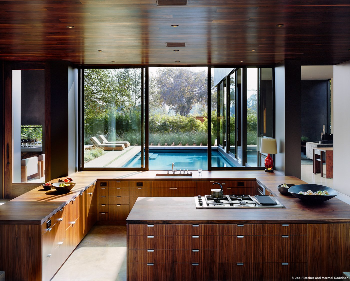 #ViennaWayResidence #modern #midcentury #inside #interior #windows #lighting #kitchen #wood #appliances #table #seating #counter #outdoor #exterior #pool #landscape #Venice #California #MarmolRadziner  Vienna Way Residence by Marmol Radziner