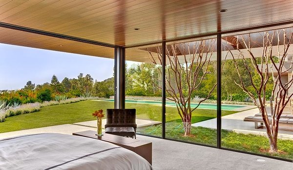 Modern home with bedroom. Photo 6 of Trousdale Residence