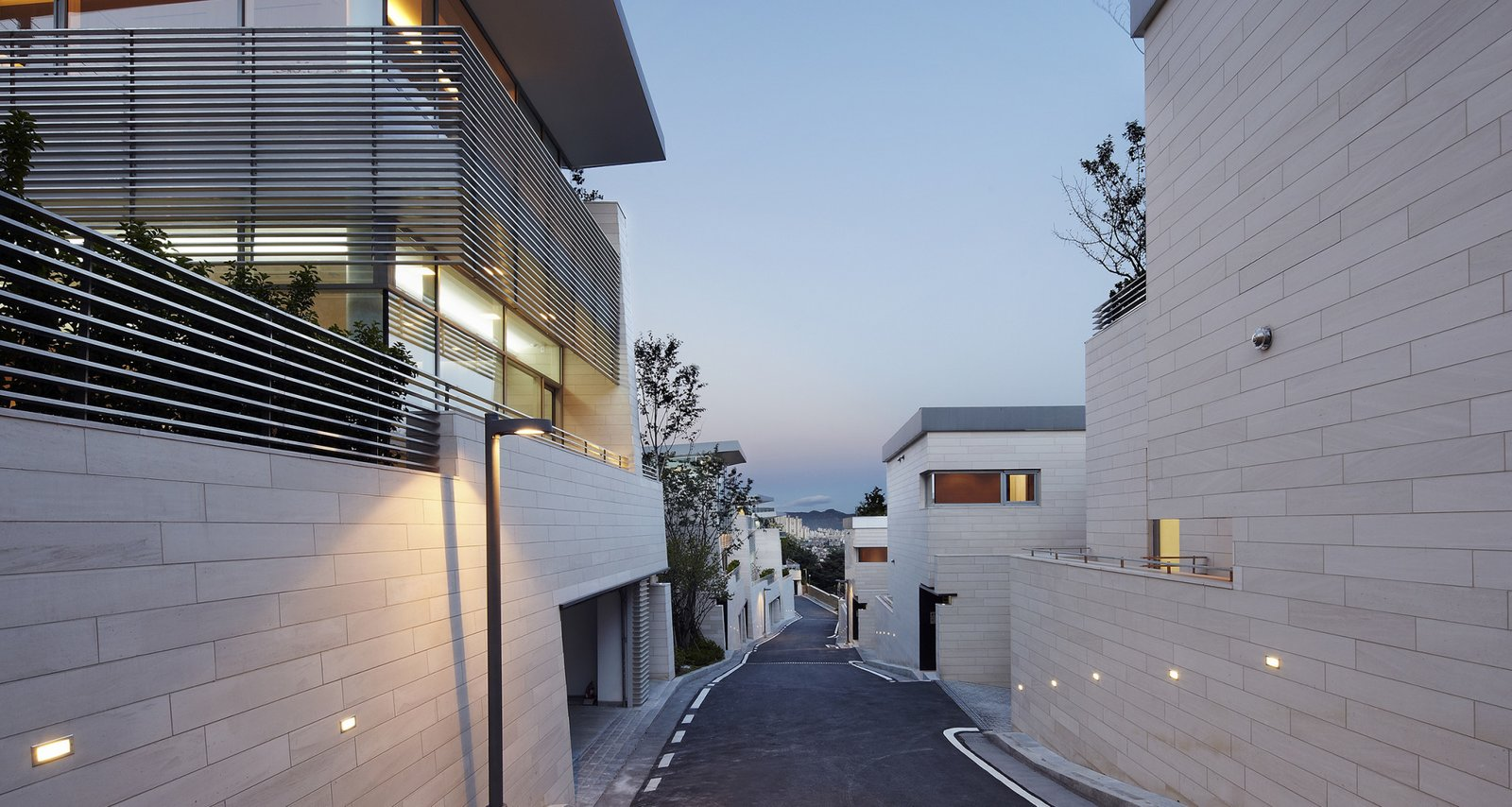 #SeongbukdongResidence #modern #midcentury #enclave #sustainable #L-shaped #exterior #outside #outdoors #structure #street #lighting #geometry #garage #driveway #Seoul #JoelSandersArchitects  Seongbukdong Residence by Joel Sanders Architect