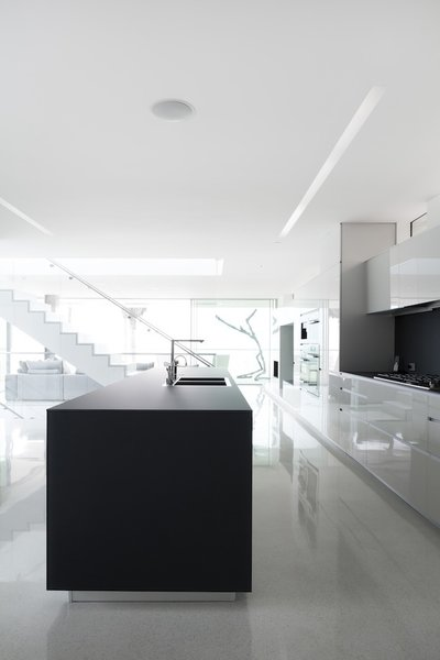 #danbrunn #flipflop #beachfront #residence #venice #california #glass #kitchen #stairs #windows #interior  Photo 20 of Flip Flop Residence modern home