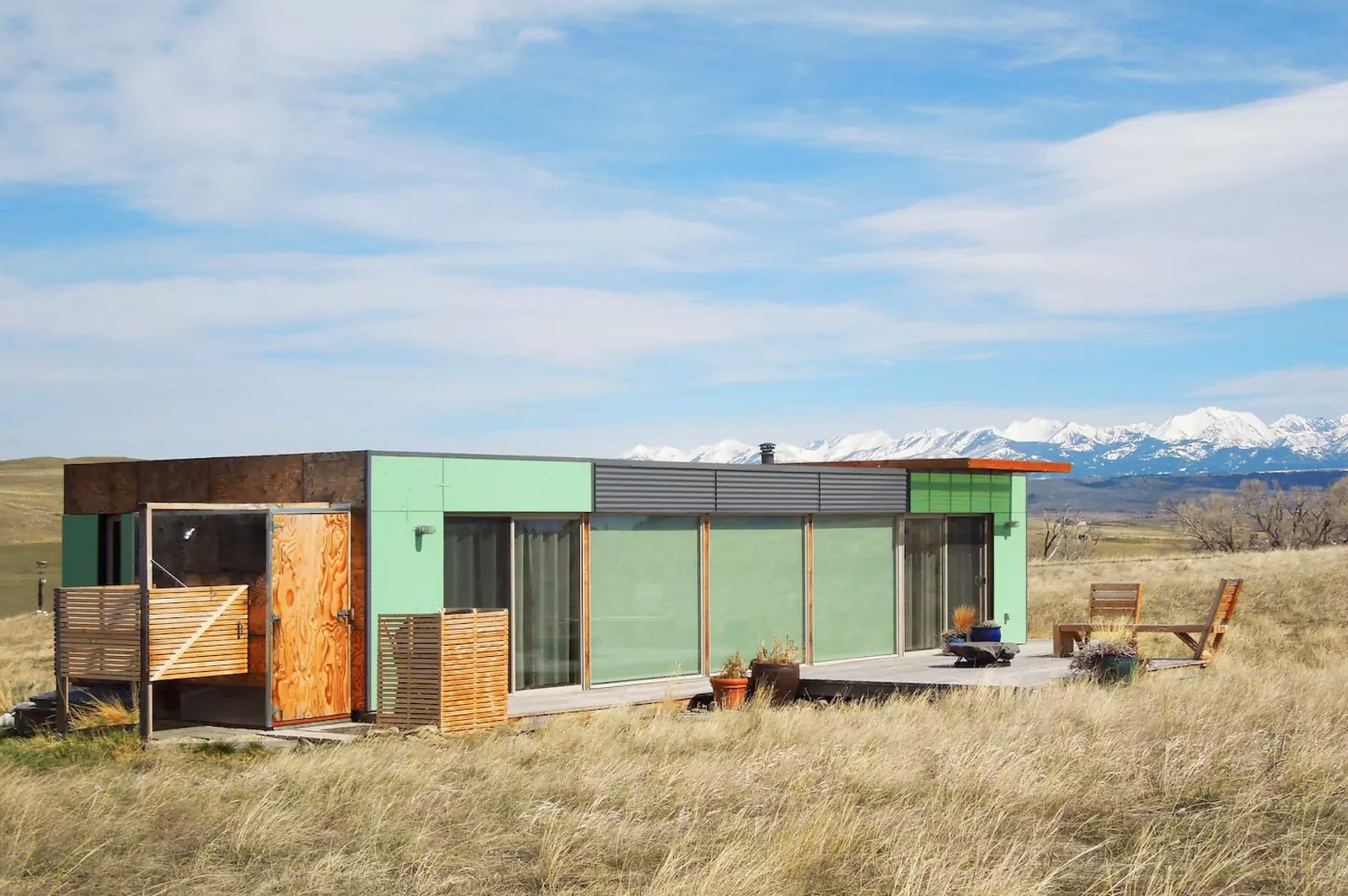 """Shipping Container Home Livingston, MT, United States  Welcome to the """"Little Box on the Prairie"""". This unique, modern house is made from two recycled shipping containers, situated on 10-acres of rolling prairie, just North of Livingston Montana. It's a 700 square-foot mix of rustic coziness and clean, modern design. Many of the finishes such as the redwood flooring and plywood wall panels were salvaged off site, recycled and reused. The outside deck is perfect for chatting over morning coffee, an evening glass of wine, gazing at the Absaroka Mountains and likely spotting a deer or antelope. The house comfortably sleeps 2, and a 3rd can sleep on the sofa if needed.  https://www.airbnb.com/rooms/3292920  Amazing Examples of Shipping Container Architecture by Diana Budds from Great Airbnbs"""