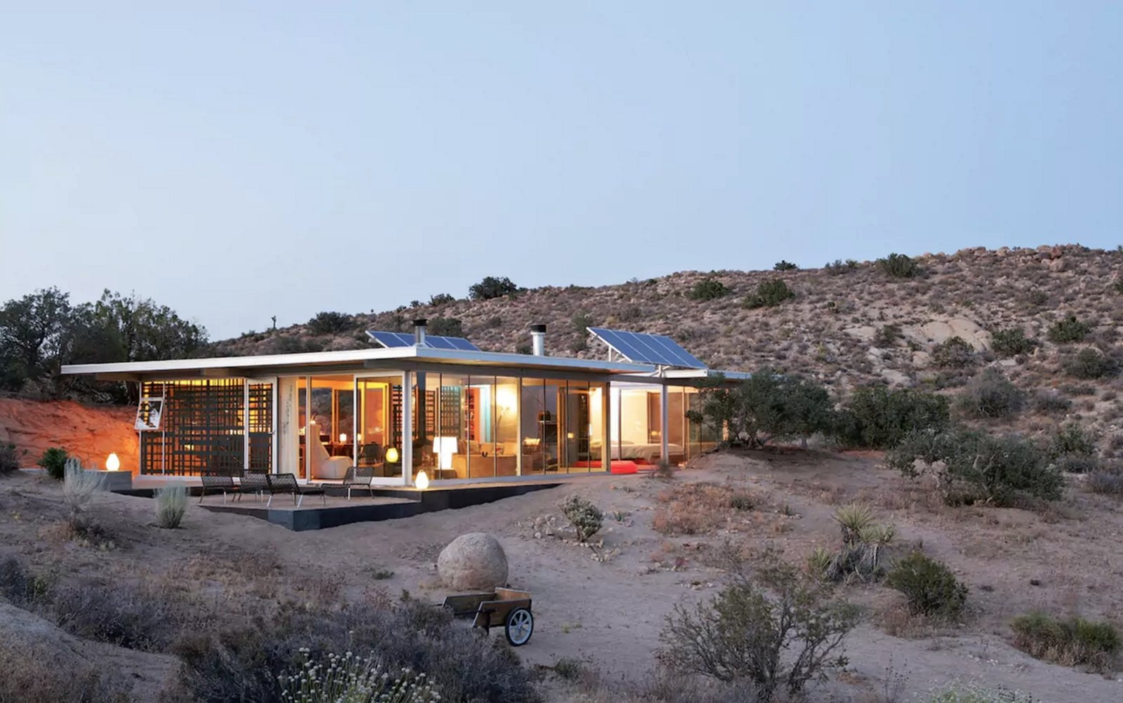 Off-grid itHouse Pioneertown, CA, United States  The Off-grid itHouse is an architecturally significant house, recently noted by Dwell as one of the 'Best Homes in America' and in the Los Angeles Times as one of the best houses of all time in Southern California. The Off-grid itHouse is one of 10 IT Houses built in California, which have received much acclaim such as the Western Home award sponsored by Sunset magazine. Also noted as one of the top 10 airbnb rentals worldwide. This is the prototype for the pre-engineered system known as the IT House.  The house is 100% off-grid, powered by solar panels for energy and hot water, and is located in a pristine remote valley in the beautiful California high desert. The house observes key green principals of smaller footprint, minimal disturbance to the natural beauty of the surrounding landscape, use of renewable resources, and living simply and minimally.  The setting of the house is remote and serene, a quiet refuge from everything, free from distractions. Amazing views and vistas in all directions.  Perfect for design or green aficionados, writers or those needing a secluded quiet getaway.  https://www.airbnb.com/rooms/19606 Tagged: Exterior, House, and Glass Siding Material.  Modern, Off-the-Grid Homes by Aileen Kwun from Great Airbnbs