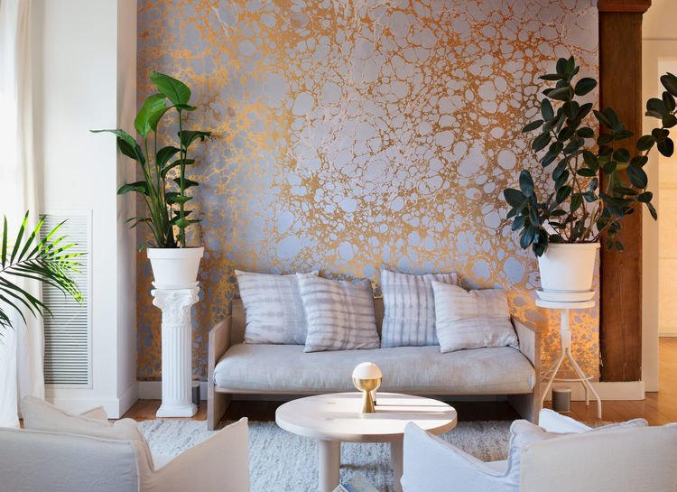 Inside the Brooklyn home of Calico Wallpaper founders Nick and Rachel Cope. The silver and gold Wabi River wall covering shown is their own design. (Photo by Dean Kaufman)  Lush Life by Heather Corcoran from Wallpaper