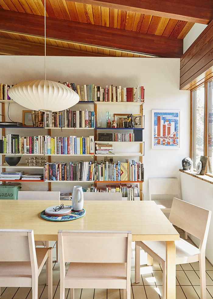 Michael Marriott bookshelves in an England home kitchen, paired with a Nelson bubble lamp and Artek table and chairs. Swoon.  30+ Modern Homes With Libraries by Matthew Keeshin from Bookshelves