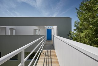 "The main entry, accessed via a footbridge that extends beyond the building envelope and into the site, leads to the upper-level floor. ""It is truly a house of opposites,"" said the architect. ""To leave the house, for instance, you go up instead of down."""