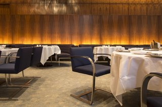 Wright Auctions Off Items from the Seagram Building's Four Seasons - Photo 3 of 4 - The Grill Room featured cantilevered Brno chairs by Ludwig Mies van der Rohe and banquettes by Philip Johnson, who was known to dine at his preferred seat, at table 32.