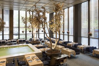 Wright Auctions Off Items from the Seagram Building's Four Seasons - Photo 1 of 4 - Featuring a bubbling water feature punctuated with seasonal trees, the International Style–designed Pool Room was home to many a power lunch over the years.