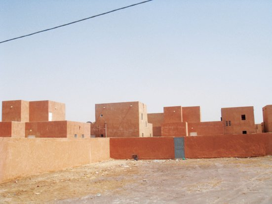"""Adjaye snapped this residential block in Nouakchott, Mauritania. """"Wealthy housing is of the compound and villa type, with Arabic decoration,"""" he says. """"Apartment buildings are normally three or four stories high, and more of them are being built. Low-cost housing is state built and organized in quarters.""""  David Adjaye's African Architecture Photo Survey by Aileen Kwun"""