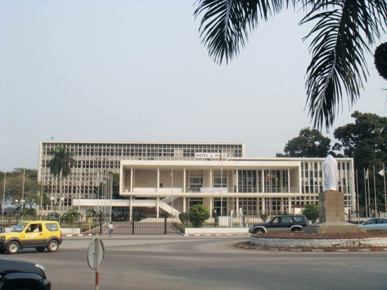 """Adjaye took this photo of a civic building in Brazzaville, Republic of the Congo. """"Often dilapidated, these buildings are slowly being brought back to full use. City hall has touches of Terragni, constructed of white marble with fine brises-soleil. More recent administrative buildings have a tendency towards White House pastiche, a 90-degree turn from the city's modernist legacy.""""  David Adjaye's African Architecture Photo Survey by Aileen Kwun"""