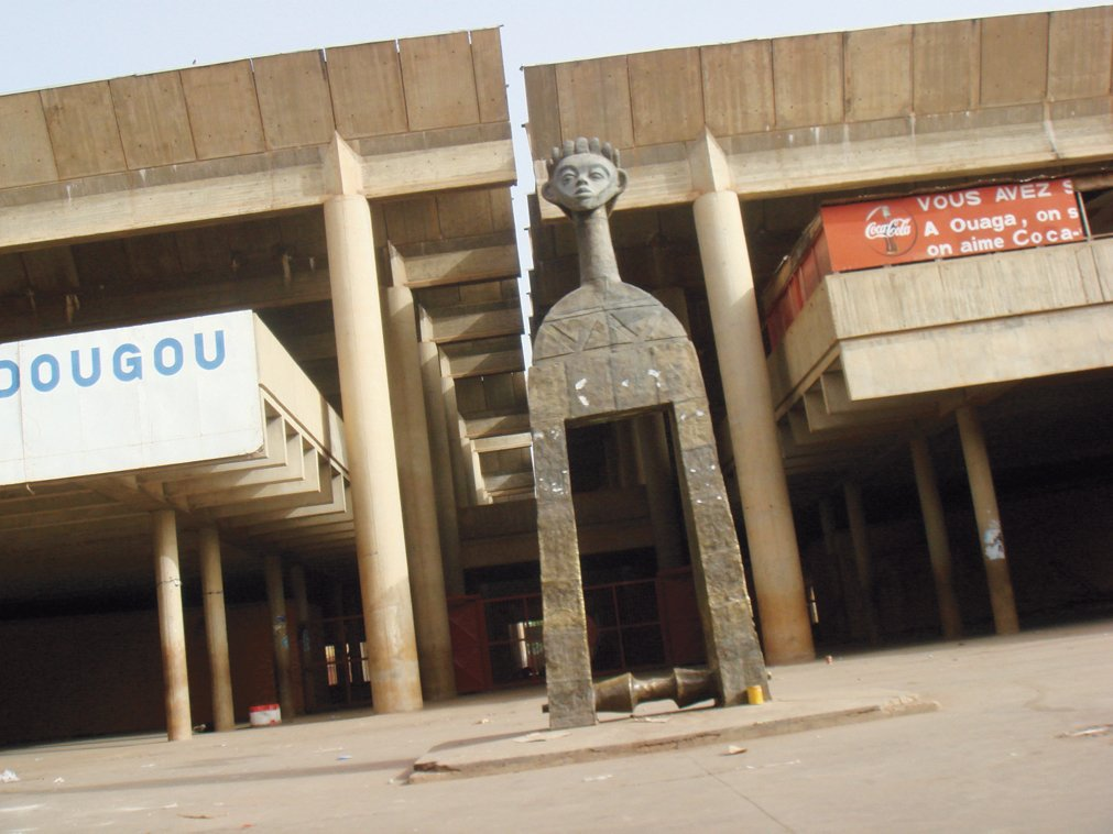 """""""The banks and large businesses have built the only high-rise buildings in the city, which combine African and futurist motifs,"""" Adjaye notes of this commercial complex in Ouagadougou, Burkina Faso. """"Since most of the public and commercial buildings are constructed in concrete, the architecture has a handmade quality.""""  David Adjaye's African Architecture Photo Survey by Aileen Kwun"""