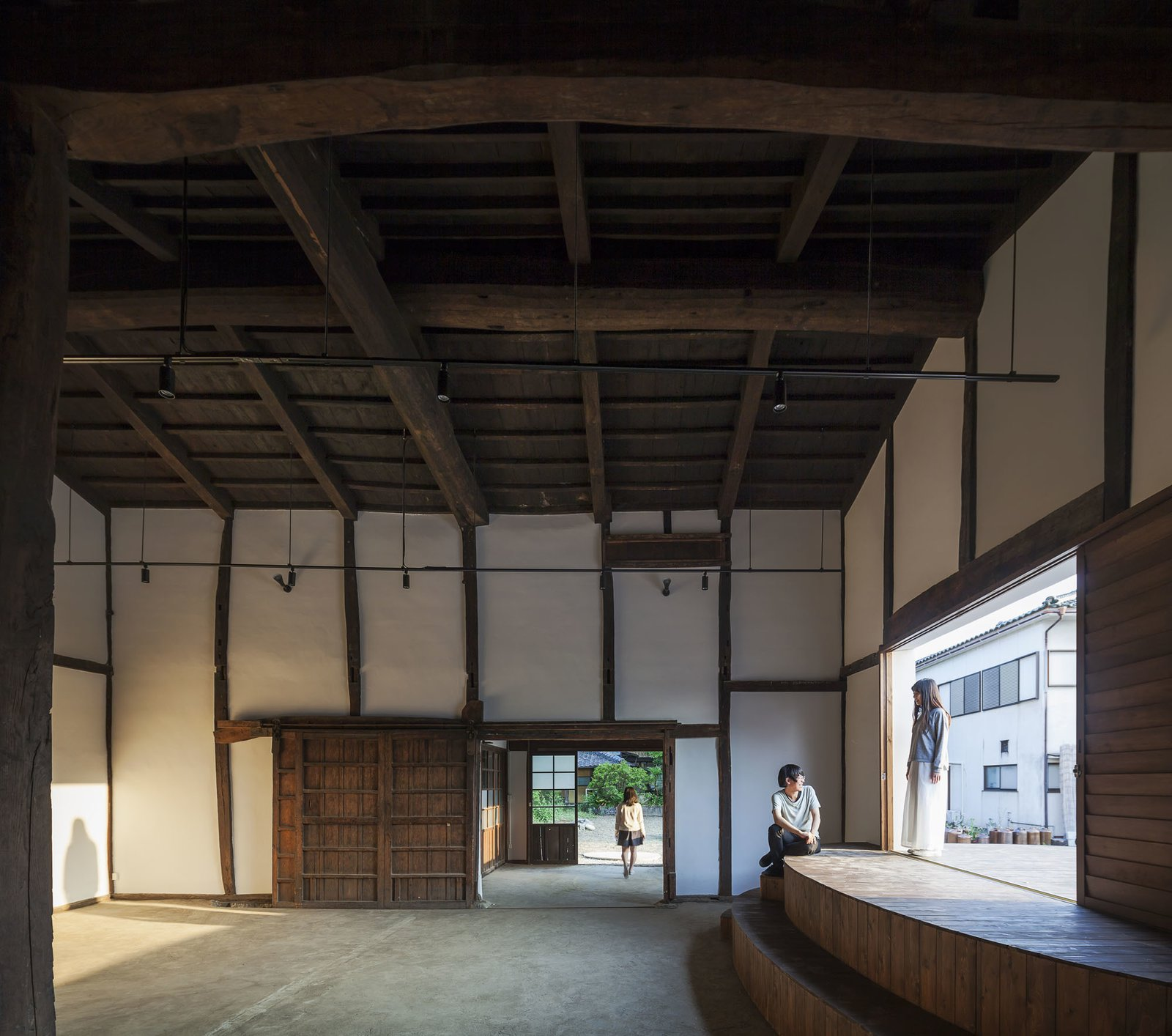 Activating the warehouse into a venue, a new stage was added to the interior for performances and meetings.  Photo 5 of 8 in Saved From Demolition, a Japanese Sake Warehouse Sees a Second Life