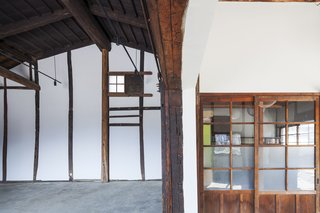 Saved From Demolition, a Japanese Sake Warehouse Sees a Second Life - Photo 3 of 7 - Wooden detailing, found in many traditional kura warehouses, was restored in the interior.