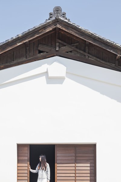 Saved From Demolition, a Japanese Sake Warehouse Sees a Second Life - Photo 2 of 7 - Architect Jorge Almazán, members of his studio lab at Keio University, and local community members worked to preserve as many historic details as possible, including the original roof tiles.