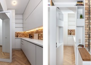 A Hidden Passageway Makes Each Room in This Berlin Flat a Private Destination - Photo 4 of 6 - Concealed doors make the service area double as a private passageway. A mirror-lined door connects to the master suite (left); at the other end, a pivoting shelf door (right) leads to the kitchen and dining area. For the resident, an entrepreneur of a cold brew coffee business, the service area is also his home workspace.