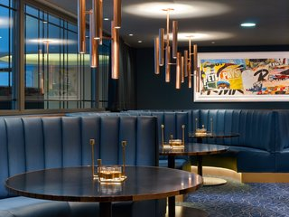 Varied seating options in the hotel's Jazz Club Etoile include leather banquettes; a new row of windows lines an interior wall to evoke an urban feel.