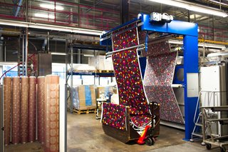 For Marimekko's  Artwork Studio Manager,  Print's Not Dead - Photo 5 of 6 - Once printed, fabrics are run through a mechanical dryer, which presses and sets all the layers of color in place. Marimekko's team then inspects and views each roll of textile by eye for any mistakes along process. Approved rolls are then shipped off to vendors and, in some cases, make their way onto any of the brand's myriad clothing items, products, or home accessories.