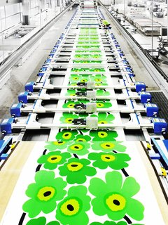 For Marimekko's  Artwork Studio Manager,  Print's Not Dead - Photo 4 of 6 - Once the screen printed graphic is finalized and approved by the creative and production teams, the pattern is printed onto cotton fabrics using long flatbed machines.
