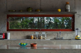 With a View of the Andes, This Concrete Retreat in Ecuador Follows the Sun - Photo 3 of 5 - Poured by hand on site, nearly the entire structure of the El Quinche House—including the kitchen counters and sinks—was made of concrete sourced from a local quarry.