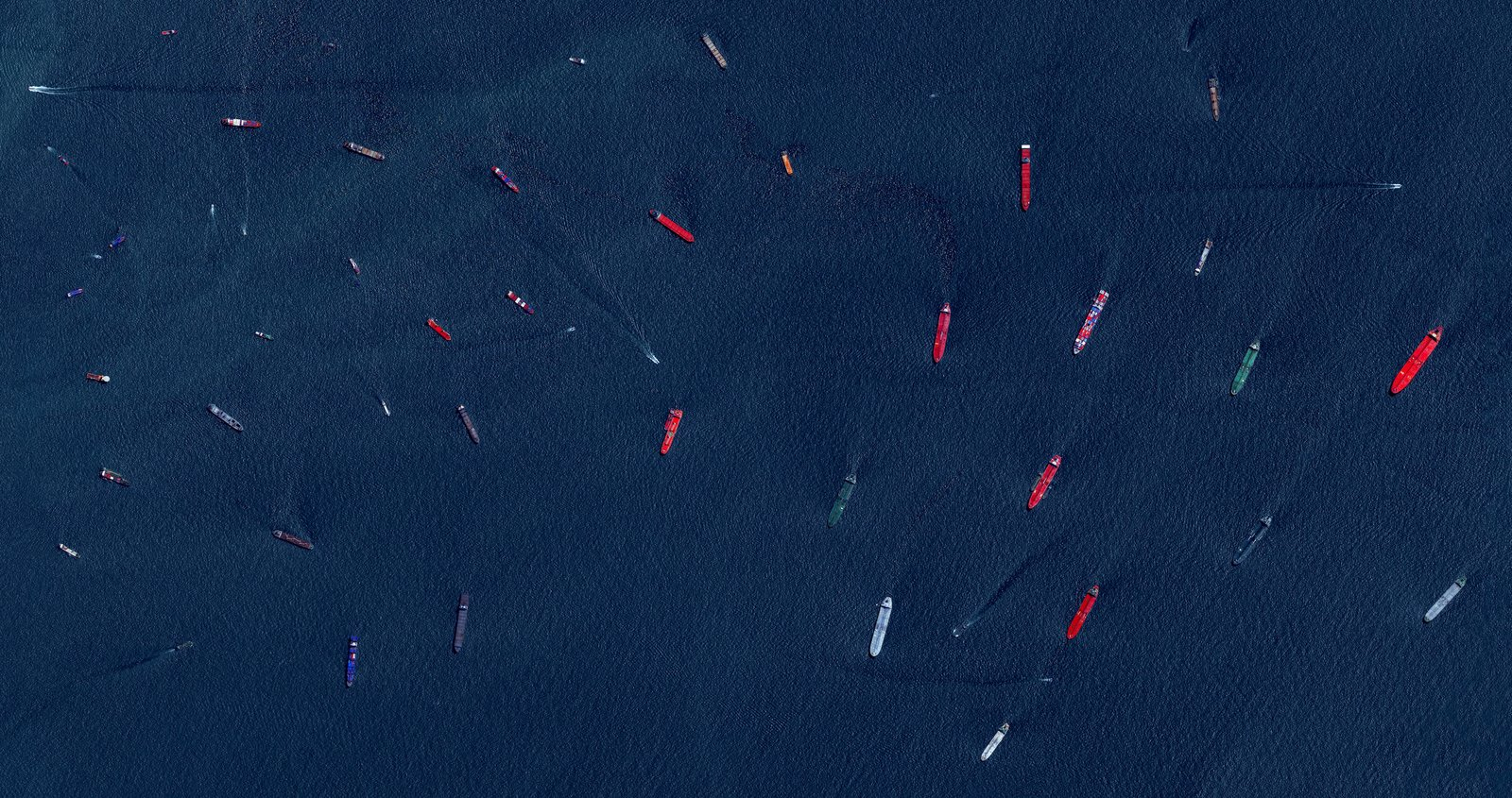 The Port of Singapore ships a fifth of the world's cargo containers, making it the world's second busiest port. Reprinted with permission from Overview by Benjamin Grant, copyright (c) 2016. Published by Amphoto Books, a division of Penguin Random House, Inc.   Images (c) 2016 by DigitalGlobe, Inc.   Ever Wondered About the View from Space? by Aileen Kwun