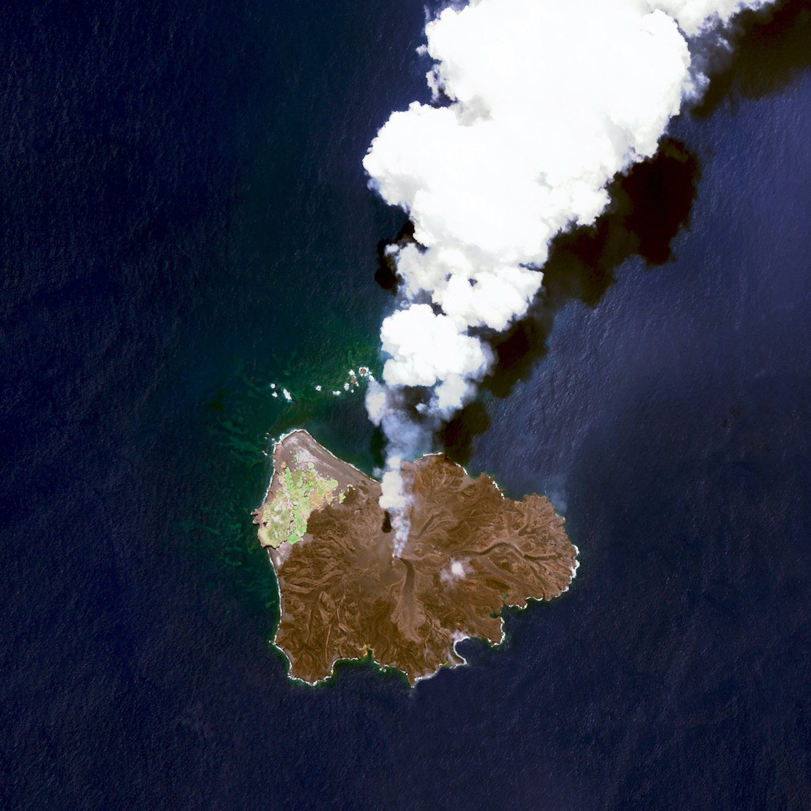 A volcanic island located 584 miles south of Tokyo, Japan, Nishinoshima began to erupt in November 2013, and continued through August 2015.  Reprinted with permission from Overview by Benjamin Grant, copyright (c) 2016. Published by Amphoto Books, a division of Penguin Random House, Inc.   Images (c) 2016 by DigitalGlobe, Inc.   Ever Wondered About the View from Space? by Aileen Kwun