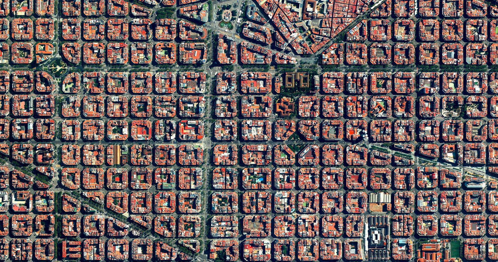 Clusters of housing with communal courtyards are placed along a strict grid pattern in Barcelona's Eixample district, shown here. Reprinted with permission from Overview by Benjamin Grant, copyright (c) 2016. Published by Amphoto Books, a division of Penguin Random House, Inc. Images (c) 2016 by DigitalGlobe, Inc.