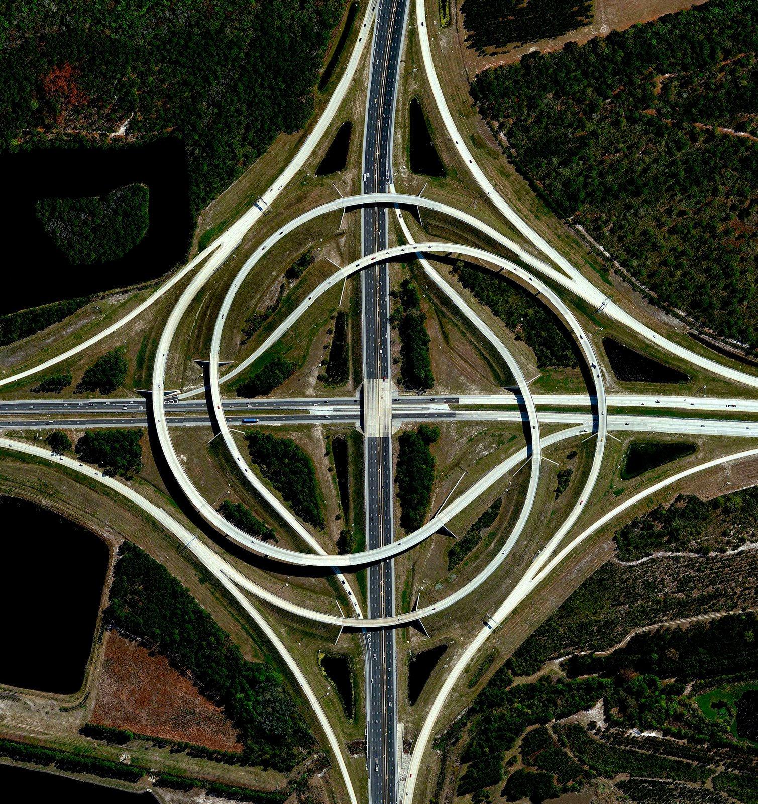 A view of two swirling highways in Jacksonville, Florida. Reprinted with permission from Overview by Benjamin Grant, copyright (c) 2016. Published by Amphoto Books, a division of Penguin Random House, Inc.   Images (c) 2016 by DigitalGlobe, Inc.   Ever Wondered About the View from Space? by Aileen Kwun