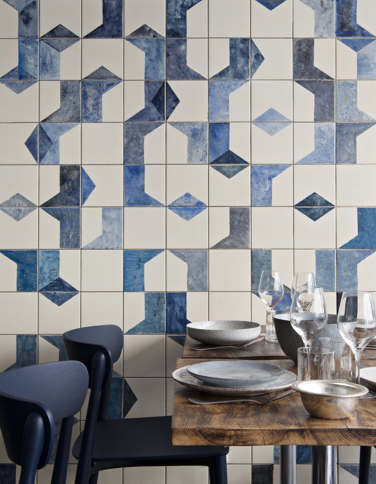 A closer look at the hand-painted, ceramic tile fresco on the ground level of Belle Maison. Bonaventure also specified ceramic dishes and tableware from Broste Copenhagen; the navy blue Nemea chairs are from Pedrali.  Photo 3 of 6 in A Parisian Seafood Restaurant, Swimming in Shades of Blue
