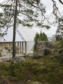 A Swedish Summer Cabin That Sits  Above and Among the Trees - Photo 1 of 6 - On Viggsö, an island of the Swedish Archipelago, architecture firm Arrhov Frick designed a two-story retreat, using simple but hardy materials. The timber frame is made of pine; the roof is made of corrugated metal and fiber-reinforced plastic.