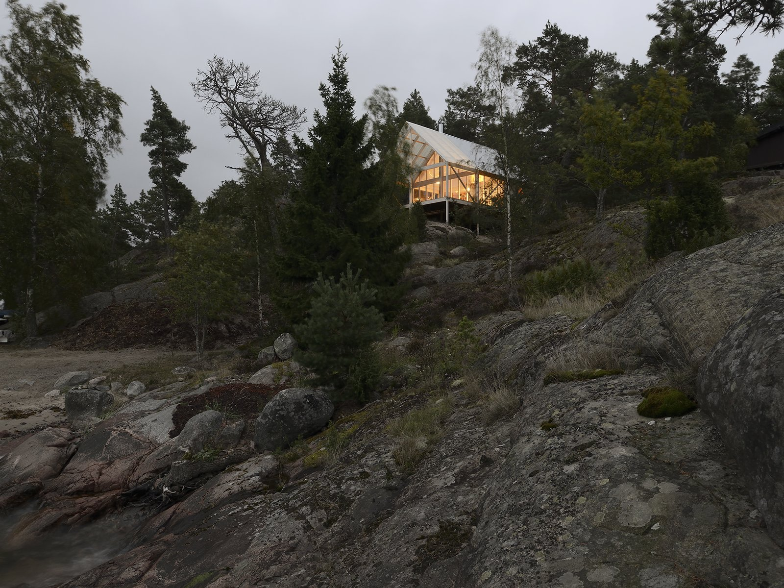 Though a clear celebration of Sweden's intense but fleeting summer seasons, the cabin is used year-round, and was constructed in eight months. Tagged: Exterior, Wood Siding Material, and House.  Photo 6 of 7 in A Swedish Summer Cabin That Sits  Above and Among the Trees