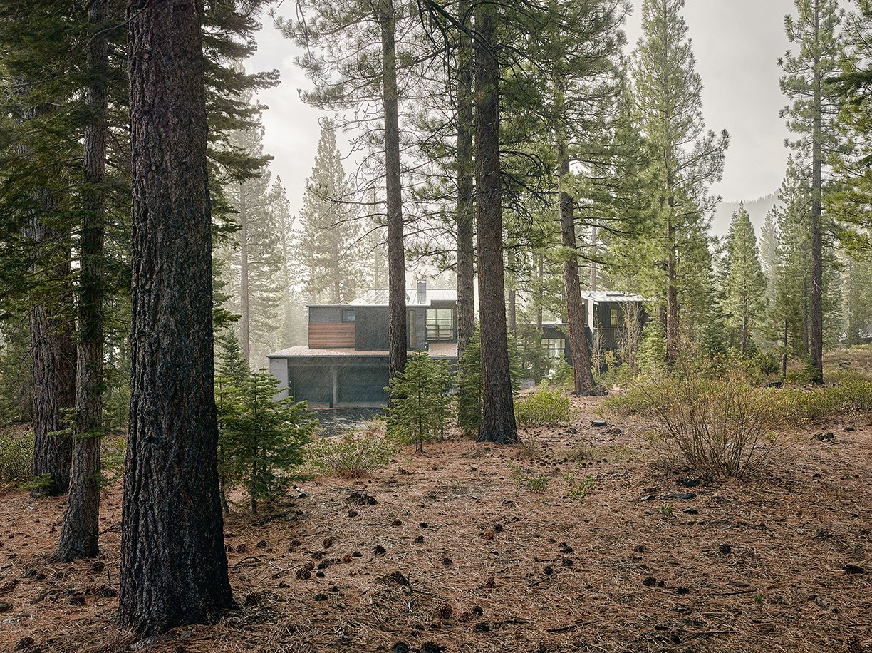 The charred cedar–clad structure in Truckee, California, was designed by architect Greg Faulkner, for a family with grown children that wanted a place to host friends. Tagged: Exterior, House, and Cabin Building Type.  Photo 2 of 6 in A Family's California Ski Retreat is Designed to Blend in With Its Site